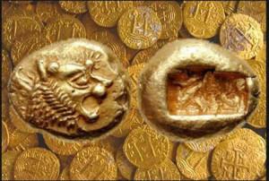 Figura destacada consistente en monedas de oro muy antiguas, de las primeras acuñaciones de la historia del dinero, de Lidia, con fondo de monedas de oro americano robado y acuñadas por el imperio español en su decadencia final, hacia 1715.